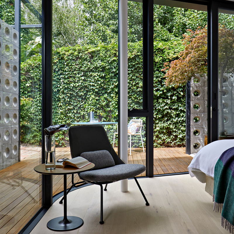 grand pavilion glass walls bedroom interiors colour styling with side table and chair